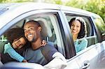 Portrait of happy family inside car