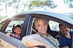Portrait of multi-generation men inside car