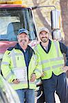 Portrait of confident roadside mechanics