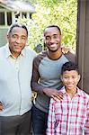 Portrait of smiling multi-generation men outdoors