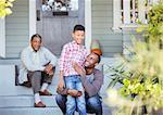 Multi-generation men on porch steps