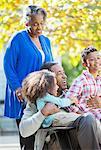 Happy grandparents and grandchildren outdoors