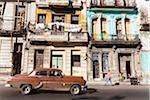 Vintage car in front of historic architecture, Havana, Cuba