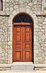 Stone church facade wooden double doors closed