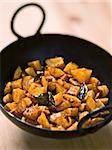 close up of a bowl of vegetarian indian potato masala curry