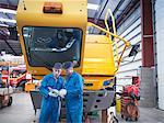 Engineers use digital tablet in truck repair factory
