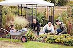 Multiethnic family gardening at yard