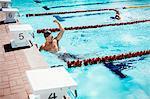 Swimmer celebrating in pool