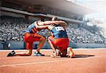 Runners huddled on track