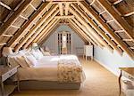 Sunny luxury attic bedroom