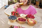 Young girl eating fresh fruits
