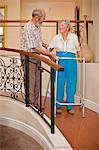 Senior couple in hallway of retirement villa