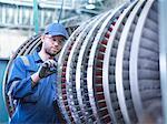 Engineer measuring high pressure steam turbine blade in workshop