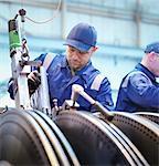Engineers fitting blades to steam turbine in repair works