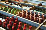 Assorted bottles of wine in wine shelves