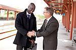 Business men having discussion on train platform