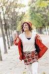 Woman Walking in Palais Royal park, Paris