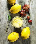 Lemon and wine foam sauce, lemon zest and grapes