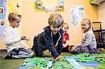 Elementary students playing in kindergarten