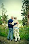 Full length rear view of senior couple looking at lake
