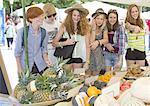 Teenage friends at market stall