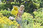 Girl watering flowers in garden