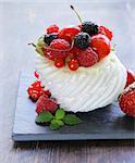 traditional summer dessert pavlova with fresh berries