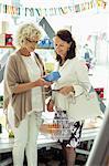 Senior female friends shopping in store