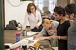 Creative businesswomen preparing plan at table in office