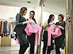Fashion designers check garment in fashion design studio