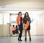 Fashion designers in fashion studio, portrait
