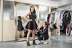 Fashion designers working together in fashion studio