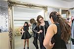 Fashion designers working together on dress in fashion studio