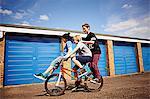 Boy giving two friends a ride on bike