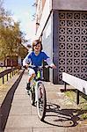 Portrait of boy cycling