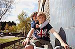 Boys giving friend a ride on bike