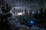 Mature man and woman exploring Buri cave, Threngsli, Iceland