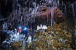 Man and woman exploring Buri cave, Threngsli, Iceland
