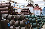 Reels of wool in storage room in woollen mill
