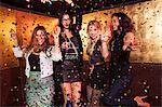 Four female friends partying in nightclub