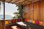 Patio bench overlooking ocean