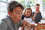 Boy drinking soft drink through straw