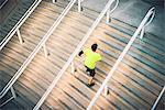 Mature male runner training on steps