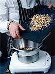 Adding the crushed hazelnuts