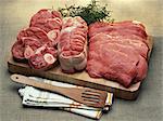 Pieces of raw pork on a cutting board