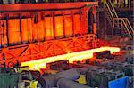 hot steel on conveyor in plant