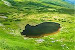 Image of a beautiful mountain lake in carpathian mountains. Chornohora massif in eastern Carpathians.