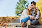 Loving couple sitting on park steps