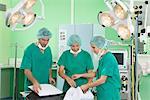 Medical team in scrubs preparing room