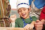 Young boy having fun in kitchen